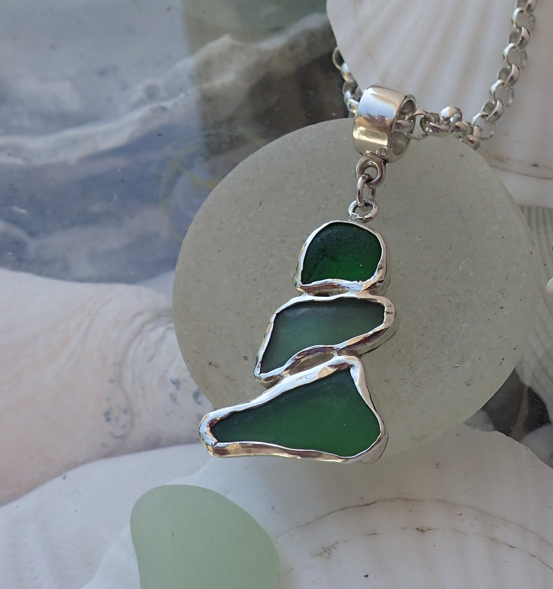 Three pieces of green authentic seaglass snuggle into a showstopping pendant